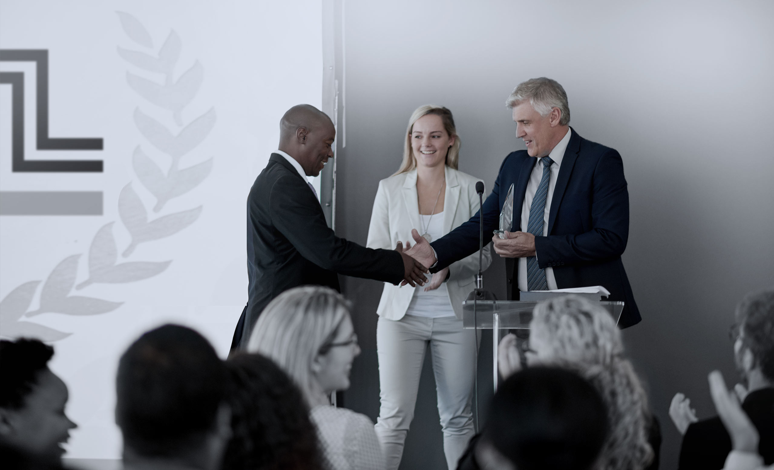 Business person receiving an award at a business conference