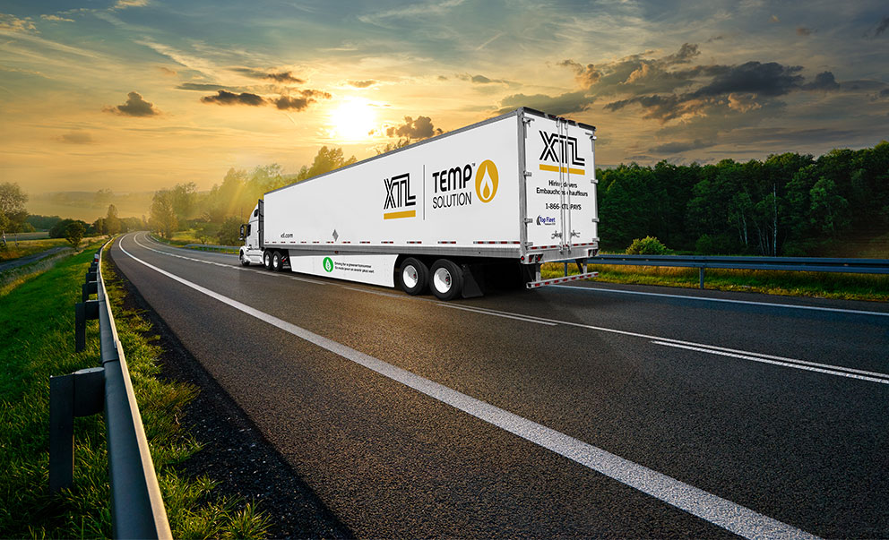 XTL transport truck hauling temp solution trailer on highway