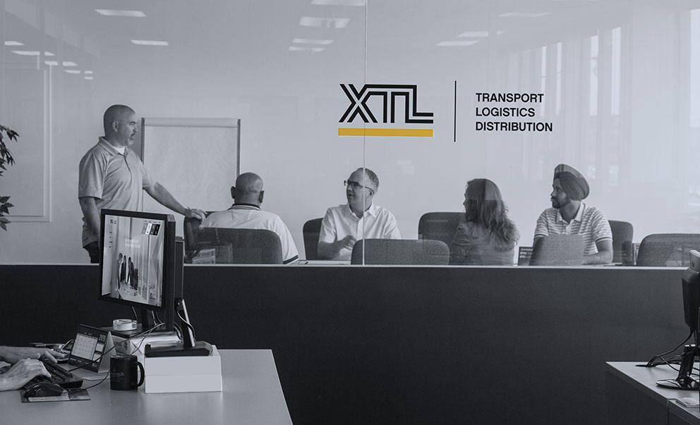 XTL staff meeting in a boardroom