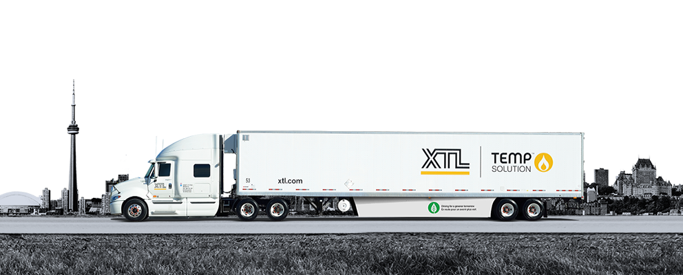 XTL transport truck and trailer driving on road with the city of Toronto in the background